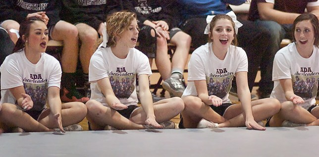 The Ada High cheerleaders yell for their wrestlers last week. That night they wore t-shirts with my photo of them.