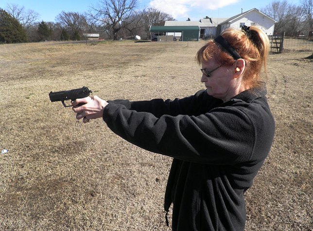 Abby shoots her .380 at our pond recently. We both legally carry firearms, and neither of us care if you are black or white, young or old: if you threaten our lives, we will defend ourselves.
