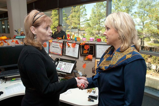 While photographing Oklahoma Governor Mary Fallin, right, at Abby's workplace last October, I suggested she go down to meet Abby.