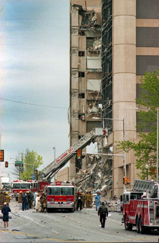Fire and rescue crews search the destroyed Murrah Federal Building in this view from the west April 19, 1995.