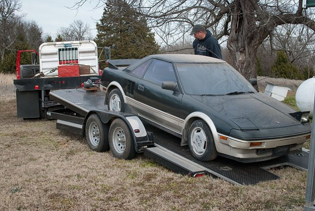 Donald loads up Abby's 1986 Toyota MR-2.