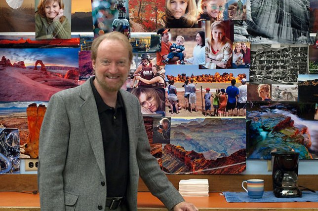 Robert made this image of me in front of the big cork board full of my photos at my office. At one point last week, I was considering taking them all down, packing them up and carting them home, but recent developments have brightened my outlook.