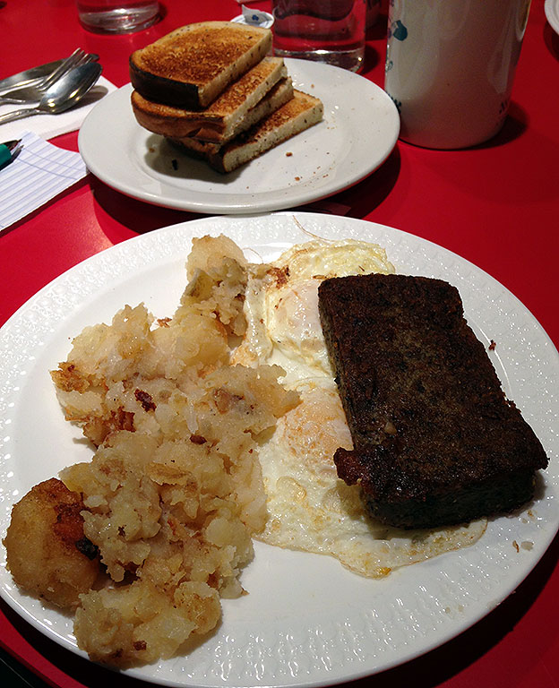 "Tom is fond of ""scrapple,"" a Baltimorean delicacy, shown here at the soon to be closed Bel-Loc Diner near where Tom and Chele live."
