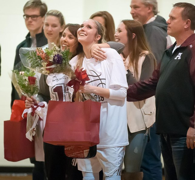 McKenzie Dean was one of the senior players honored last night. She is pictured with her parents, Angie and Steve Dean, and her sister Haley Dean. I have been photographing the Deans for most of my career.