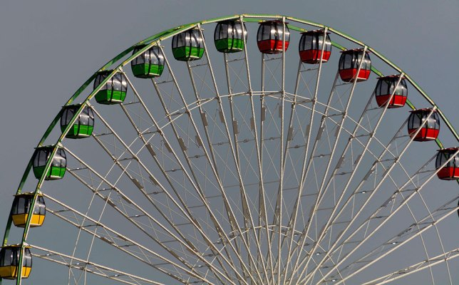Morning light strikes the Sky Eye Wheel, the largest portable Farris wheel in North America, at the Oklahoma State Fair Sunday.
