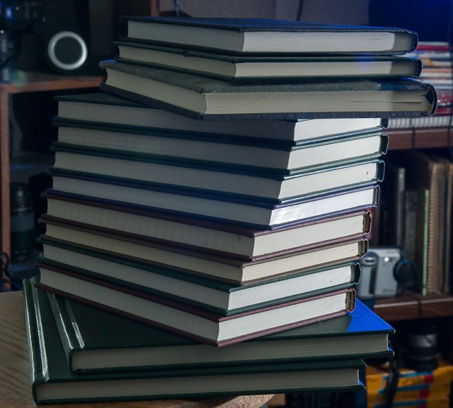 There are two empty 8.5x11-inch notebooks and 11 8x5-inch books in this stack. I want to do something with them. Their potential tasks me.