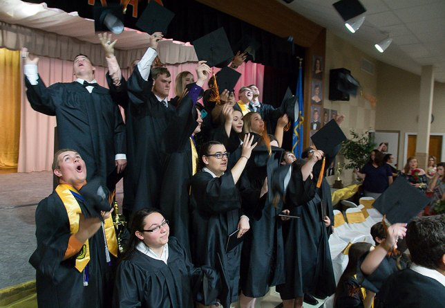 The Ryan, Oklahoma High School class of 2018 throws their mortarboards in the air after graduating Saturday night.