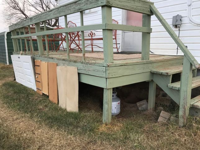 Using old doors and shelves, I mostly enclosed the area under the back deck to help shelter Hawken, our backyard wolfhound, from the cold. Also noted: when it warms back up, it's time to repaint that deck.