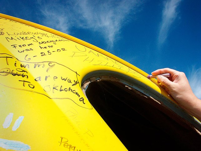 Margaret makes her mark in one of the five yellow Volkswagens of The Bug Ranch.