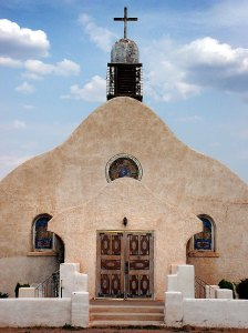 The San Ysidro, New Mexico, mission church stands elegantly in soft afternoon light.