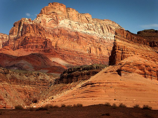 The commanding Vermilion Cliffs in northern Arizona stand in brilliant morning light.