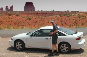 The author returns to the car after stopping by the side of the road in Monument Valley.