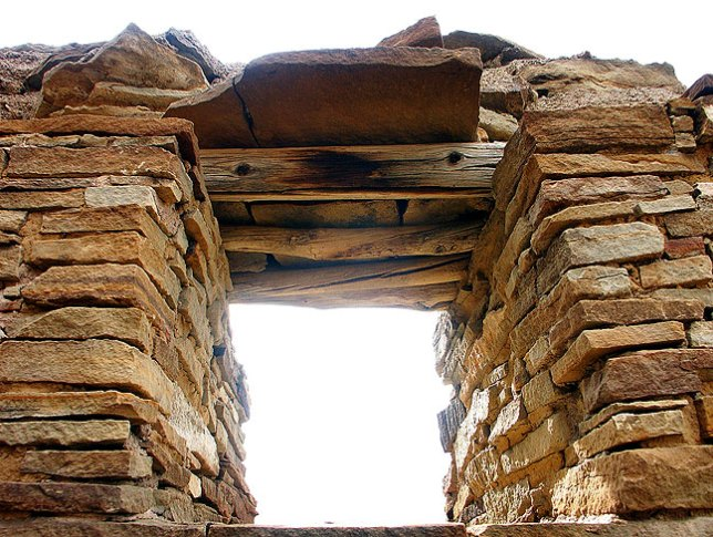 Cold light streams through a masonry window at the Peñasco Blanco Great House at Chaco Canyon.