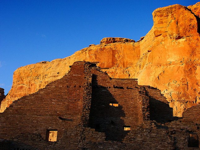 Shadow falls on back walls of Pueblo Bonito.
