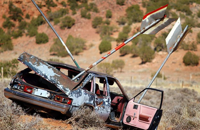When Michael caught sight of this car shot with giant arrows in the Spanish Valley south of Moab, Utah, he swing his car around so we could shoot it.