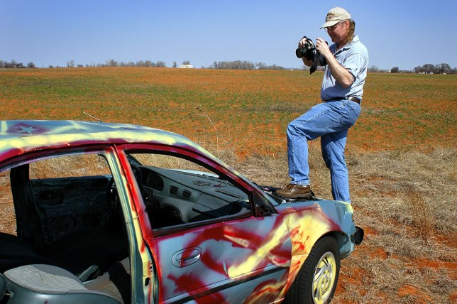 Michael photographs an abandoned car along I-40.