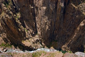 Black Canyon of the Gunnison is named for its dark stone and usually-shadowed light. This view looks straight down, and helps give the impression of the depth of the feature.