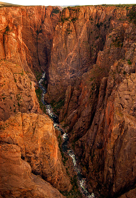 Although black in appearance during daylight hours, last light at Black Canyon brings out its amber hues.