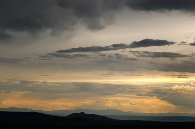 I arrived in the Raton-Clayton Volcano Field in the midst of a clearing summer thunderstorm. By the time I reached the Capulin Volcano, it had drifted to the south. The air was clear, and had that smell of high country air after a rain.