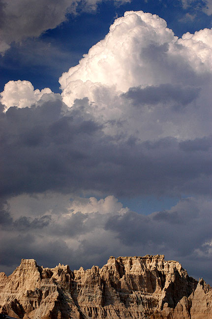A thunderstorm billows over Badlands National Park.