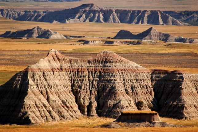 Maturing afternoon light shines on the formation of Badlands National Park.
