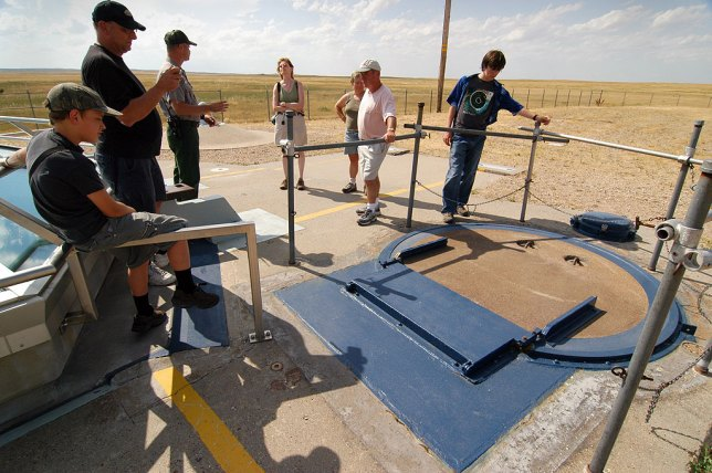 Along with other visitors, Abby listens to a park ranger talk about the Minuteman Missile.
