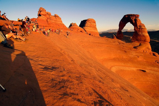 Visitors crowd the Delicate Arch area as sunset approaches.