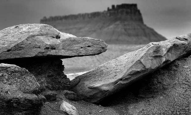Slabs of stone are set against a background of Factory Butte on my route back toward Green River.