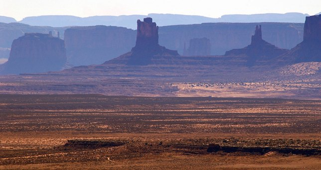 This longer telephoto view from Muley Point shows more of the features of Monument Valley, which we visited the next day.