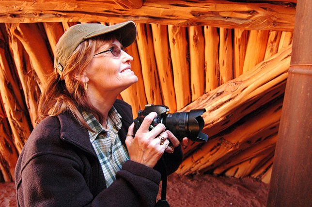 Abby photographs a hogan at the Monument Valley Tribal Park.
