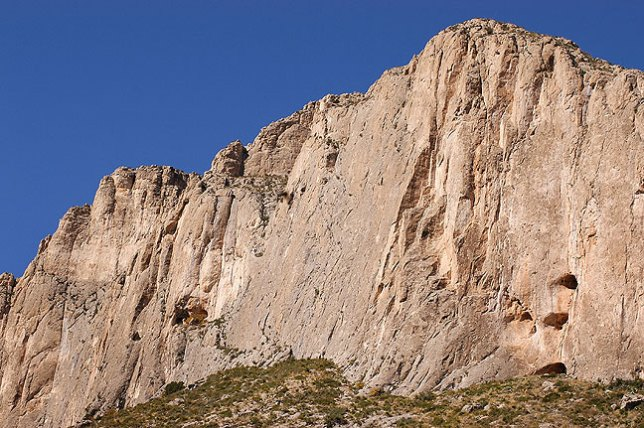 An imposing sheer cliff face greets visitors on the Permian Reef trail.