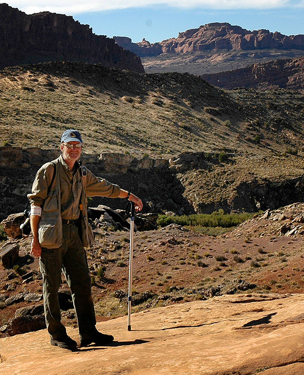 Your host poses with Abby's hiking pole on the Delicate Arch trail.