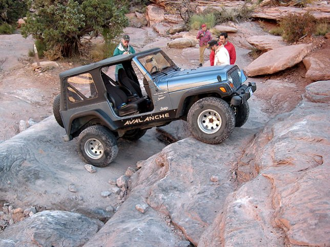 Jeep drivers attempt to ascend the Moab Rim Jeep Trail, one of the most difficult in the area.