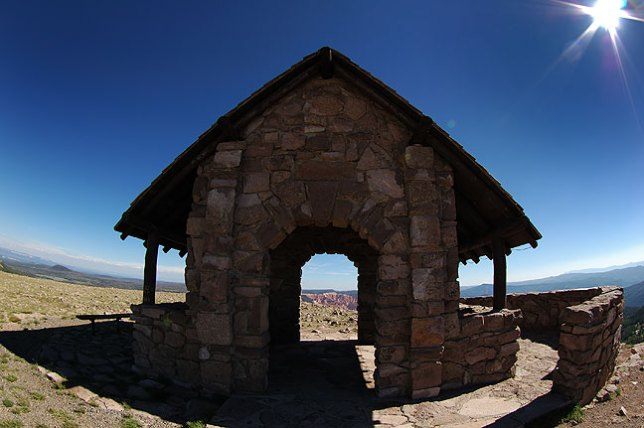 Fisheye view of shelter house, Brian Head Peak, Utah; the peak, at 11,307 feet, is just above the tree line.