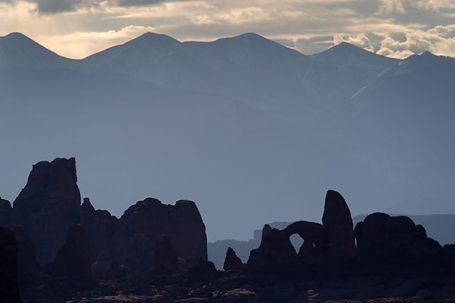 The La Sal Mountains and Turret Arch, viewed from the Klondike Bluffs section of Arches National Park, Utah.