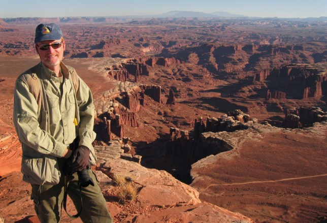 The author poses at the end of the excellent White Rim Overlook trail at Canyonlands National Park.