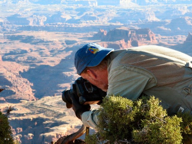 The author prowls around the White Rim Overlook trail to get an image.