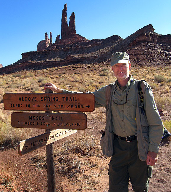 Your host poses at the Zeus and Moses loop trail head at the end of the 5.1-mile Alcove Spring trail, Canyonlands.