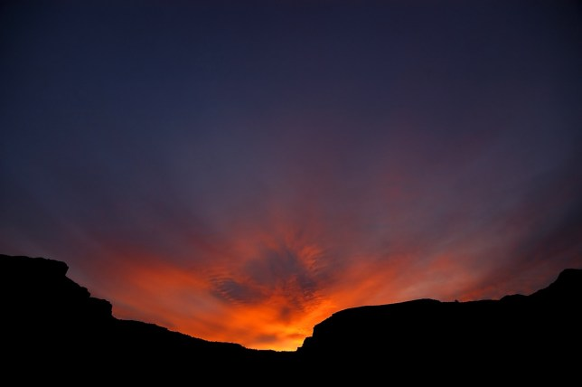 Last light fills the shape created by the canyon of the Colorado River.