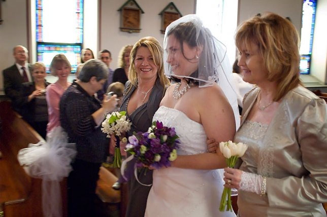 Escorted down the aisle by Kim and Abby, Chele is all smiles.