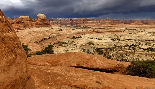 A beautiful and foreboding thunderstorm descends on The Needles at Canyonlands.