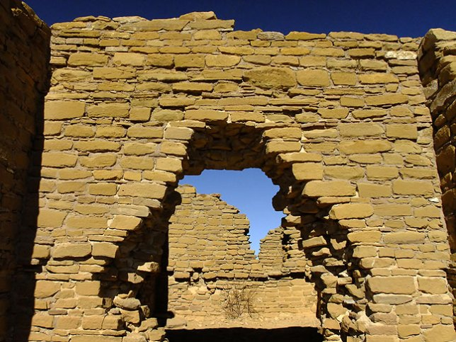 This view shows a masonry doorway in the New Alto great house complex near the top of the trail. From New Alto and Pueblo Alto, hikers can see many miles of desert to the north.