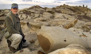 The author poses in a hoodoo field in the Bisti Wilderness.