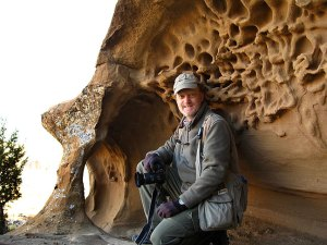 Your host poses in an eroded alcove on the switchbacks up the South Mesa trail.