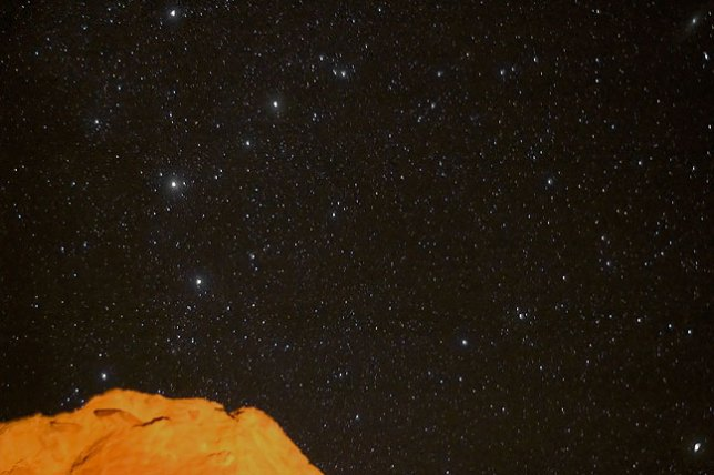 A nice star field is visible from Gallo Campground; the orange light on the cliff face is from my camp fire.