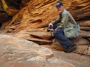 Your host hikes on the Chesler Park trail at Canyonlands.