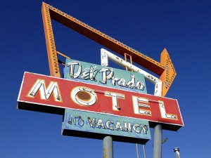 A hotel sign is set against a brilliant blue sky in Cuba, New Mexico.