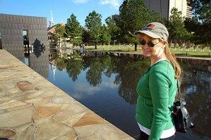 Abby walks along the reflecting pool at the Oklahoma City National Memorial.
