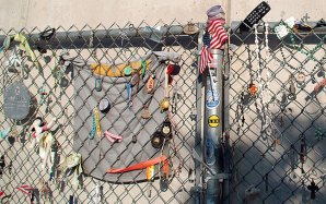 """""""The Fence"""" is a relic from the period immediately after the bombing, where people left memoirs prior to the creation of the memorial, and to this day. Abby was moved by the entire memorial, but when she got to the fence, she was unable to hold back her tears (Photo by Abby S. M. Barron)."""