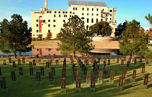 Overview showing the chairs, the reflecting pool, the Survivor Tree, and the Journal-Record building (Photo by Abby S. M. Barron).